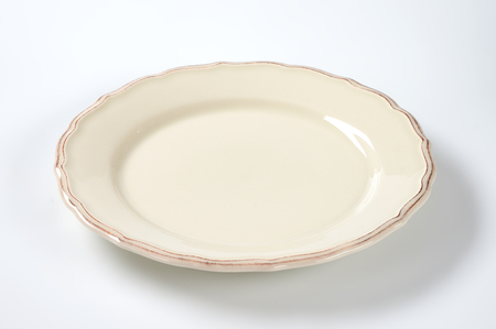 cream dinner plate with decorative edge