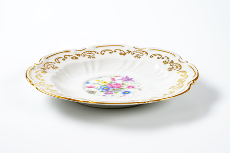 antique plate with floral pattern and decorative rim