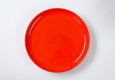 empty round red dinner plate