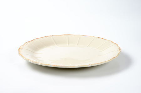 scalloped: dinner plate with embossed lines and subtle scalloped edge