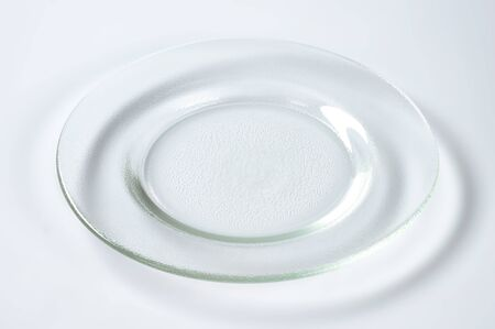 glass plate: empty glass plate with wide rim Stock Photo