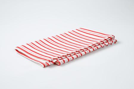 tela algodon: toalla de rayas rojo y blanco plato Foto de archivo
