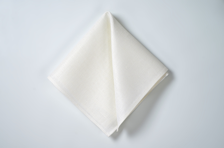 white cloth napkin on off-white background