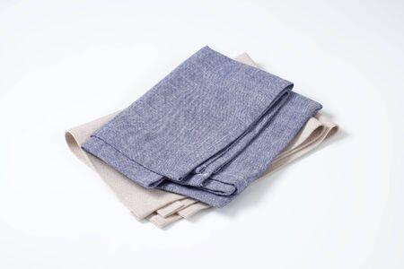 napkins: folded blue and gray napkins