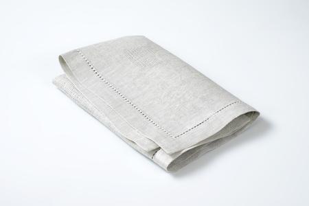 place mat: folded light grey cloth place mat