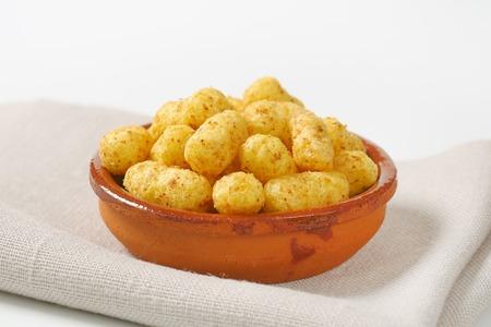 puffs: crunchy peanut puffs in terracotta bowl