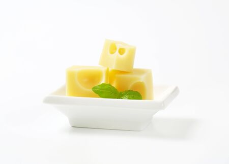 emmental: cubes of emmental cheese in white bowl