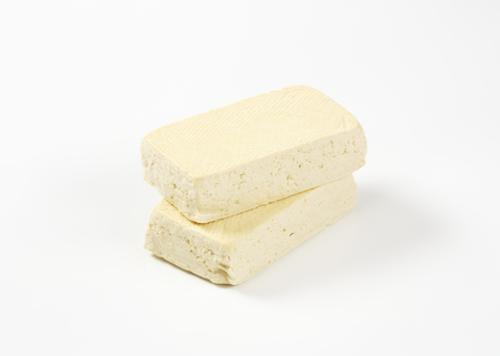 firm: Two blocks of firm tofu (soybean curd)