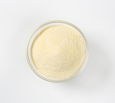 semolina: Heap of semolina flour in a glass bowl Stock Photo