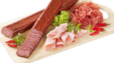 air dried: sliced salami and ham on wooden cutting board