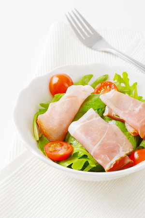 salad greens: bowl of salad greens with Black Forest ham and cherry tomatoes