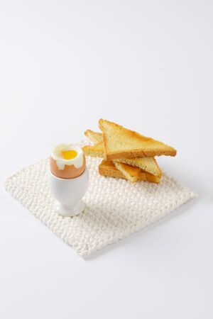 eggcup: soft boiled egg in eggcup with toasted bread