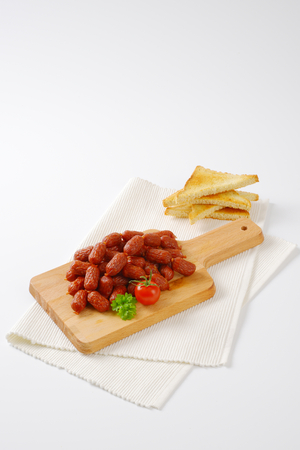 toasted: mini cabanossi sausages with toasted white bread