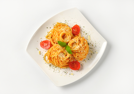 grated parmesan cheese: plate of cooked spaghetti with red pesto and grated parmesan cheese Stock Photo