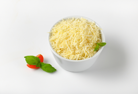 grated parmesan cheese: bowl of grated parmesan cheese Stock Photo