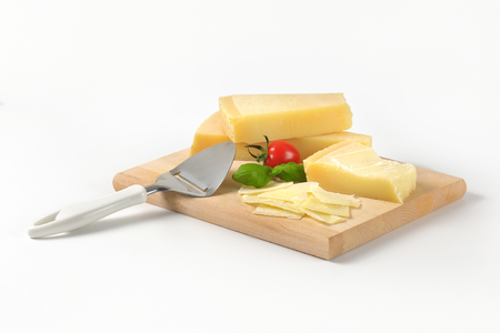 slicer: parmesan and cheese slicer on wooden cutting board