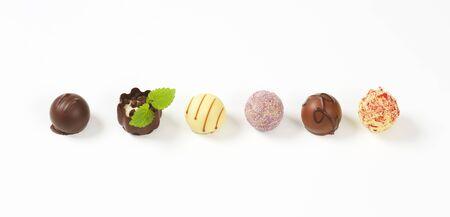 pralines: assorted belgian chocolate pralines in a row