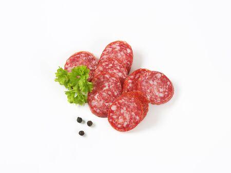 sliced salami sausage on white background