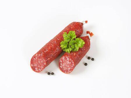 halved  half: two pieces of salami sausage