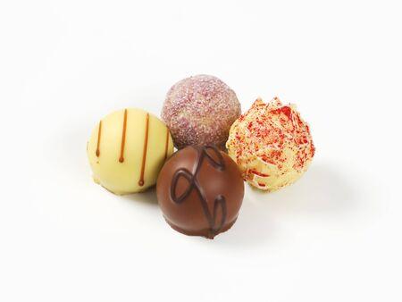 pralines: assorted belgian chocolate pralines on white background
