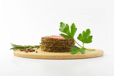 peppercorns: sliced pepper coated salami and peppercorns on wooden cutting board