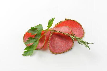 pepper salami: slices of green pepper coated salami