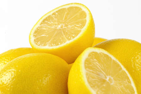 halved  half: detail of whole and halved ripe lemons