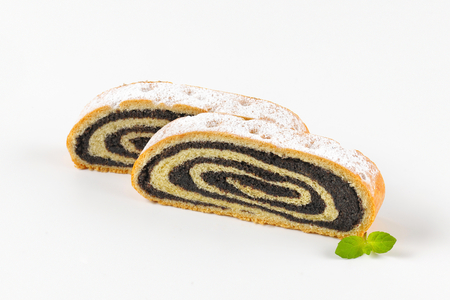 poppy seed: two slices of poppy seed roll Stock Photo