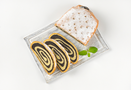 filled roll: roll of sweet yeast bread filled with poppy seed paste