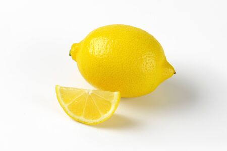 wedge: whole fresh lemon and wedge Stock Photo
