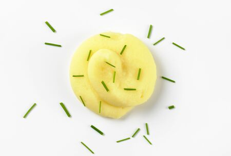 pure de papa: swirl of mashed potatoes with chives on white background