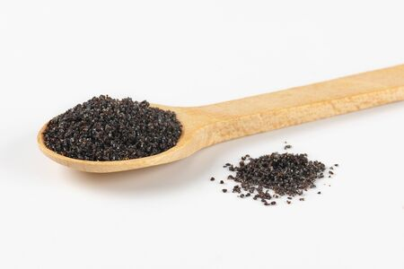 poppy seeds: ground ripe poppy seeds on small wooden spoon