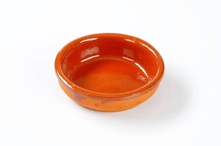 red clay: empty red clay bowl glazed on the inside
