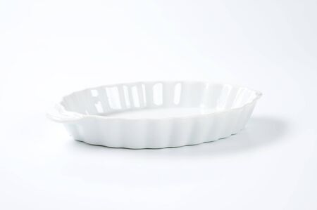fluted: empty oval fluted white casserole dish