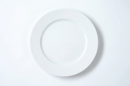 empty white dinner plate with rim