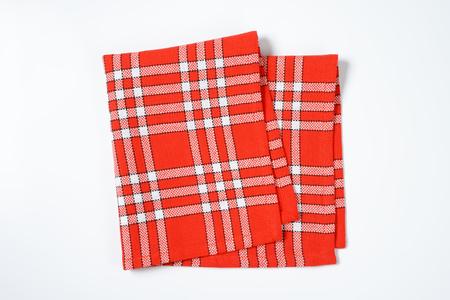 white napkin: folded checked red and white napkin