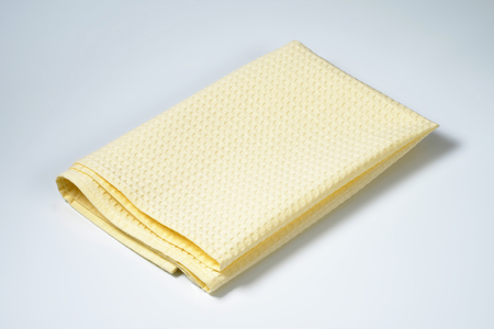 table linen: single folded creamy table linen Stock Photo