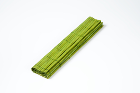 place mat: folded green bamboo place mat Stock Photo