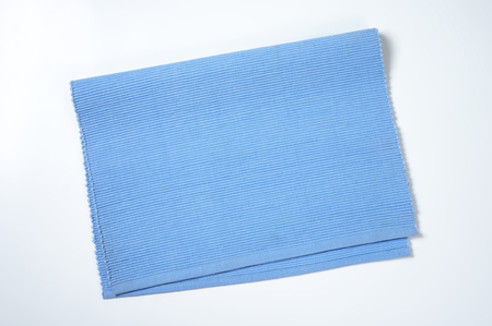 ribbed: Ribbed solid blue cotton placemat Stock Photo