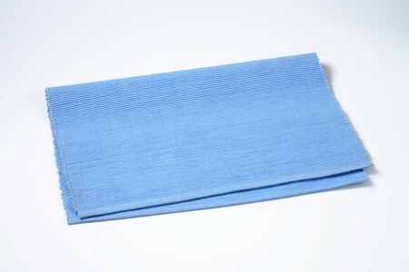 placemat: Ribbed solid blue cotton placemat Stock Photo