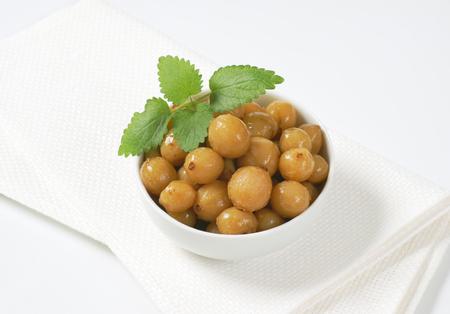 gooseberries: bowl of pickled green gooseberries
