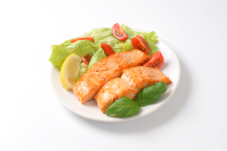 garnish: plate of roasted salmon fillets and vegetable garnish
