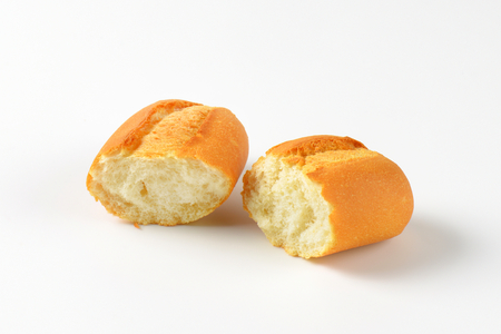 bread roll: halved fresh bread roll on white background