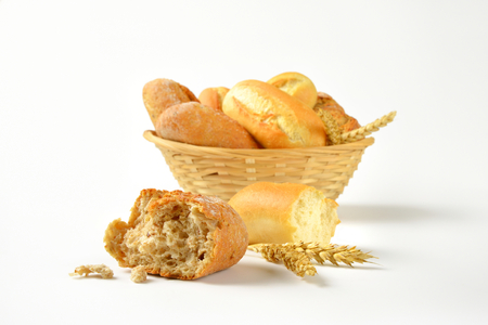 french bread rolls: basket of various bread rolls and buns on white background