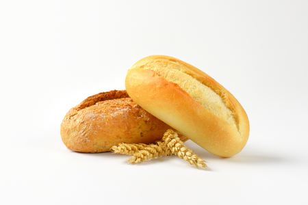 french bread rolls: three French bread rolls with crisp crust Stock Photo