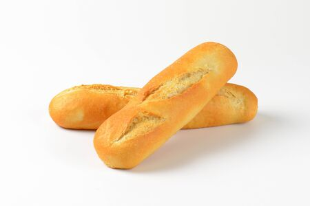 crust crusty: two loaves of French bread on white background