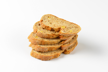 wholegrain: stack of wholegrain bread slices on white background