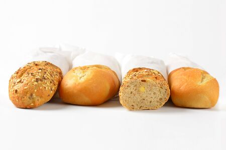 crusty french bread: white and whole grain baguettes in paper bags