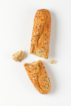 halved bread roll topped with seeds