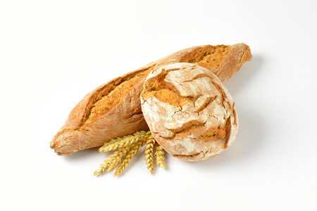 freshly baked bread and baguette on white background